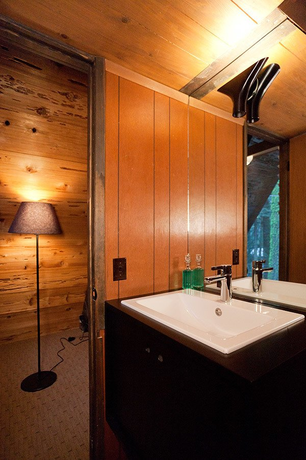 Guest Bath Tagged: Trees, Front Yard, Small Patio, Porch, Deck, Carpet Floor, Bar, Wood Patio, Porch, Deck, Standard Layout Fireplace, Table, Wood Burning Fireplace, Bed, Wall Lighting, and Bath Room.  Homewood by Popp Littrell Architecture + Interiors