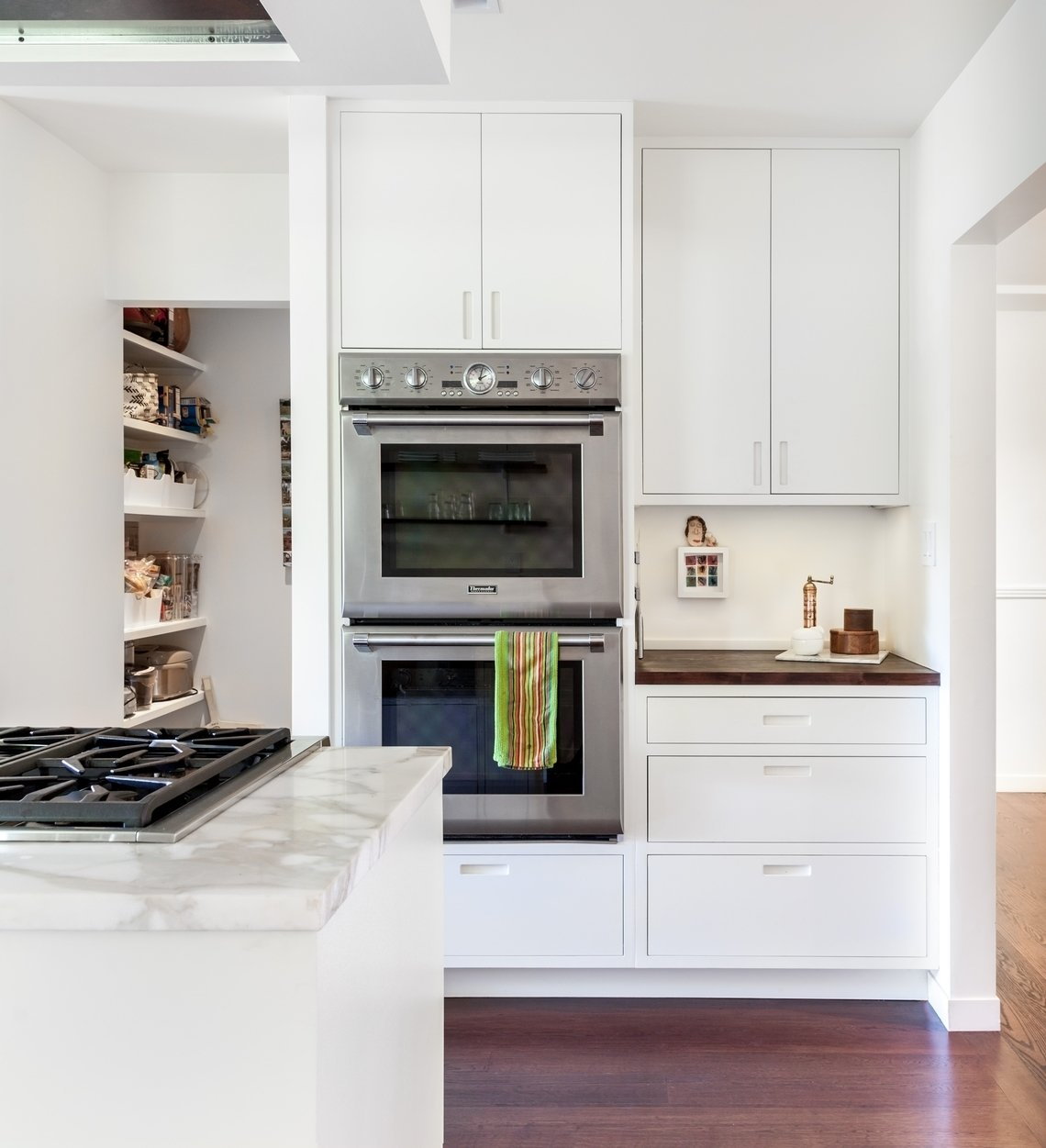 Kitchen Tagged: Marble, Dark Hardwood, Wood, White, Ceiling, Recessed, Refrigerator, Wall Oven, Range Hood, Cooktops, Dishwasher, Drop In, and Kitchen.  Best Kitchen Wall Oven Dark Hardwood Photos from Moss