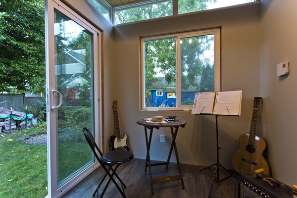 Insulation keeps noise inside this small music studio -- music turned up to the highest volume could not be heard from the main house or at the neighbors'. Photo 11 of Modern-Shed He-Shed, She-Shed modern home