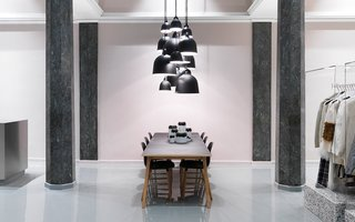 Normann Copenhagen's Revamped Showroom and Flagship Store - Photo 1 of 12 - Bell lamps in various sizes hovering above the Slice table.
