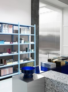Material Guide: Everything You Need to Know About Terrazzo - Photo 10 of 16 - The showroom's display podiums are made of mirrored glass, steel, acrylic, and terrazzo.