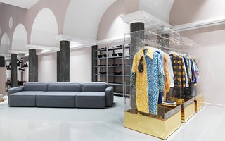Selected fashion items next to the modular Rope sofa.