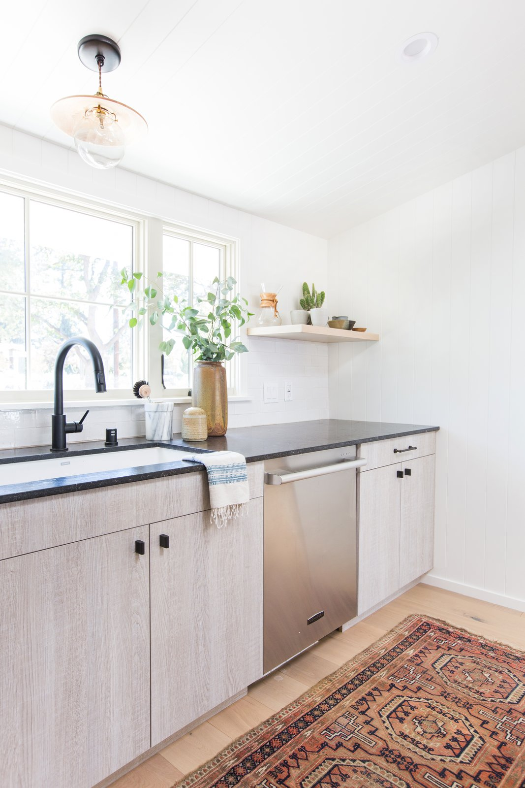 """Designer Amber Lewis's """"No Ordinary Kitchen"""" renovation features a muted palette inspired by clean Scandinavian design. Appliances by Signature Kitchen Suite, such as the dishwasher pictured here, add both style and functionality.  Hit Refresh by Dwell"""