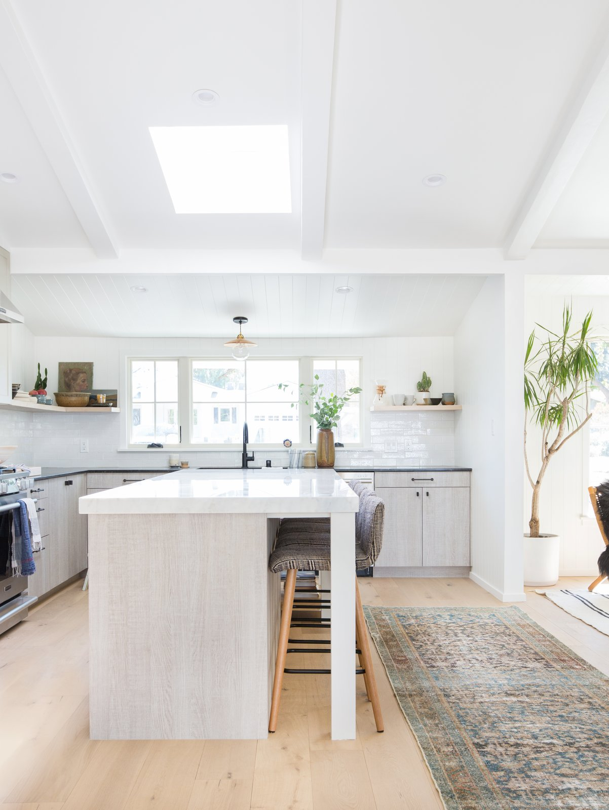 """The one thing I did love about the previous kitchen was the large window over the sink, and that's the only design element we chose to keep,"" says Amber Lewis.   from Cooking Up Style"