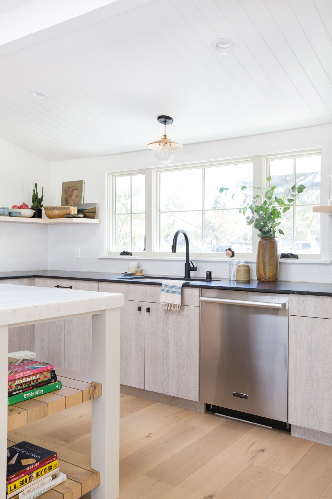 Amber Lewis's chic kitchen features a white undermount sink and a matte black faucet.