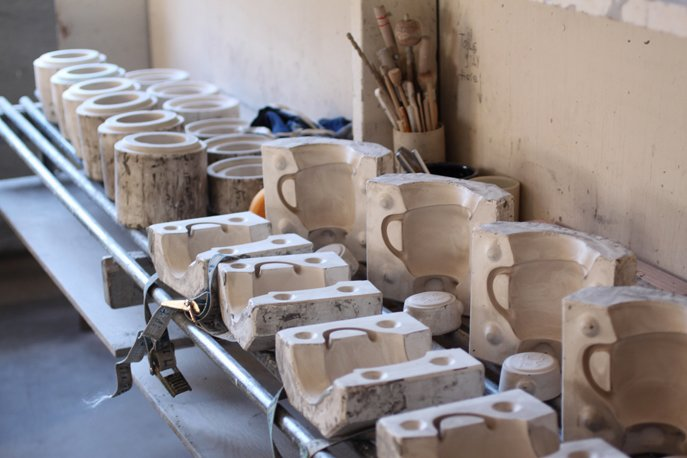 More complicated and hollow forms are made by slipcasting. Liquid clay (called slip) is poured into plaster molds (that we make on-site). The clay dries for 20-30 minutes, the remainder of the liquid clay is poured out and a