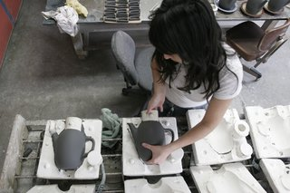 Sausalito Dinnerware Factory Tour - Photo 11 of 35 - After sitting for about half an hour the clay is firm enough that the cast forms can be removed from the molds. More drying is required before the pieces can be trimmed.