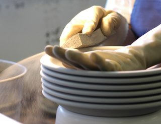 Sausalito Dinnerware Factory Tour - Photo 15 of 35 - Each piece is wiped with a wet sponge to smooth the surface.