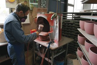 Sausalito Dinnerware Factory Tour - Photo 24 of 35 - Glaze is applied to the pieces by hand with a spray gun.