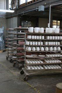 Sausalito Dinnerware Factory Tour - Photo 26 of 35 - Formed, trimmed and glazed pieces wait to be fired on a ware cart.