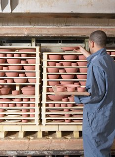 Sausalito Dinnerware Factory Tour - Photo 27 of 35 - The pieces are stacked like a puzzle, using kiln furniture, into our top-hat kilns.