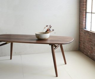 Jacob May Design - Photo 4 of 7 - Made with constantly moving city dwellers in mind, Dave developed the Nomad table (shown here in Natural Walnut) which conveniently packs down for easy travel.