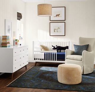 "20 Cool Cribs for the Modern Baby - Photo 6 of 20 - The Ellery swivel glider offers perfectly proportioned comfort for snuggling with your little one.<span> <a href=""/discover/madeinamerica"">#madeinamerica</a></span><span> <a href=""/discover/nursery"">#nursery</a></span><span> <a href=""/discover/furniture"">#furniture</a></span>"