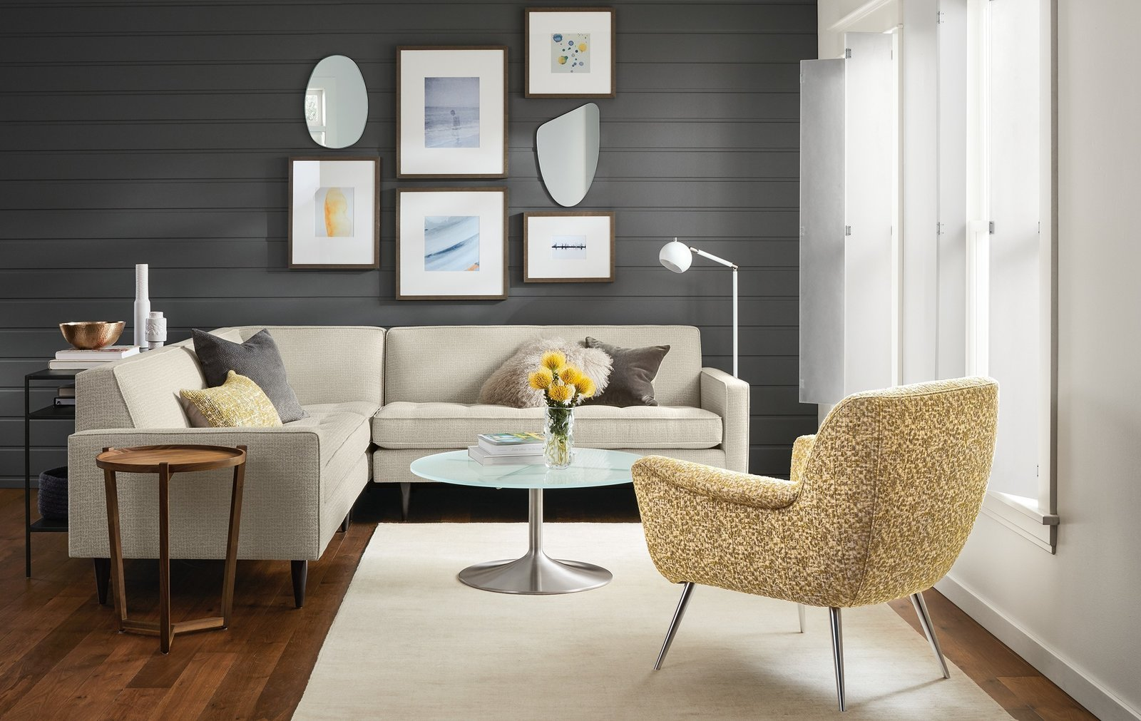 A small-scale sectional with sophisticated style, Reese adds refinement with details like button tufting, precise welting and tall, tapered legs.  Modern Living Room Furniture by Room & Board