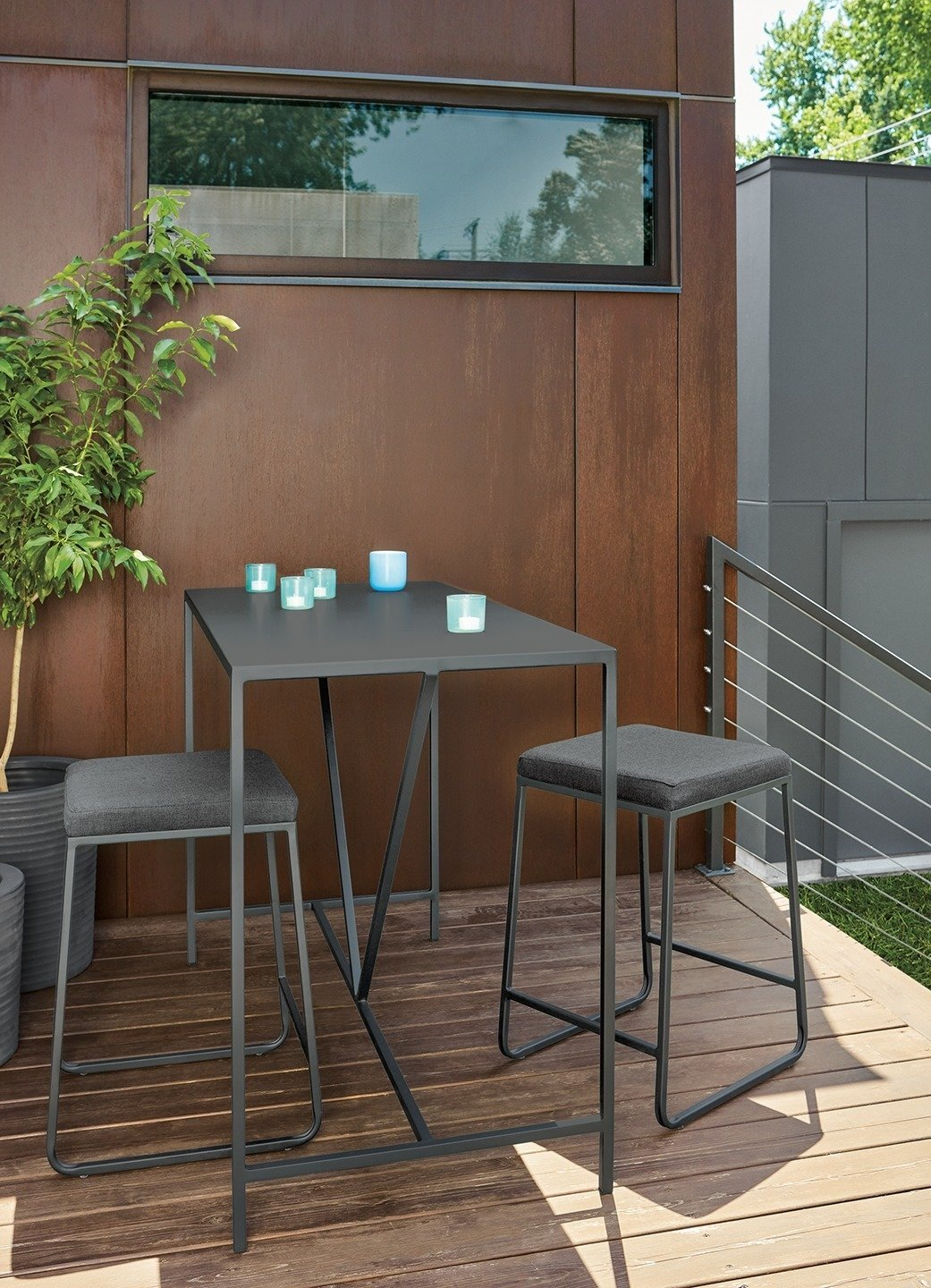 Slim counter table, Rollins stools Tagged: Outdoor, Wood Patio, Porch, Deck, Back Yard, Small Patio, Porch, Deck, and Planters Patio, Porch, Deck.  Photo 5 of 8 in Expert Design Advice: Outdoor Dining Spaces