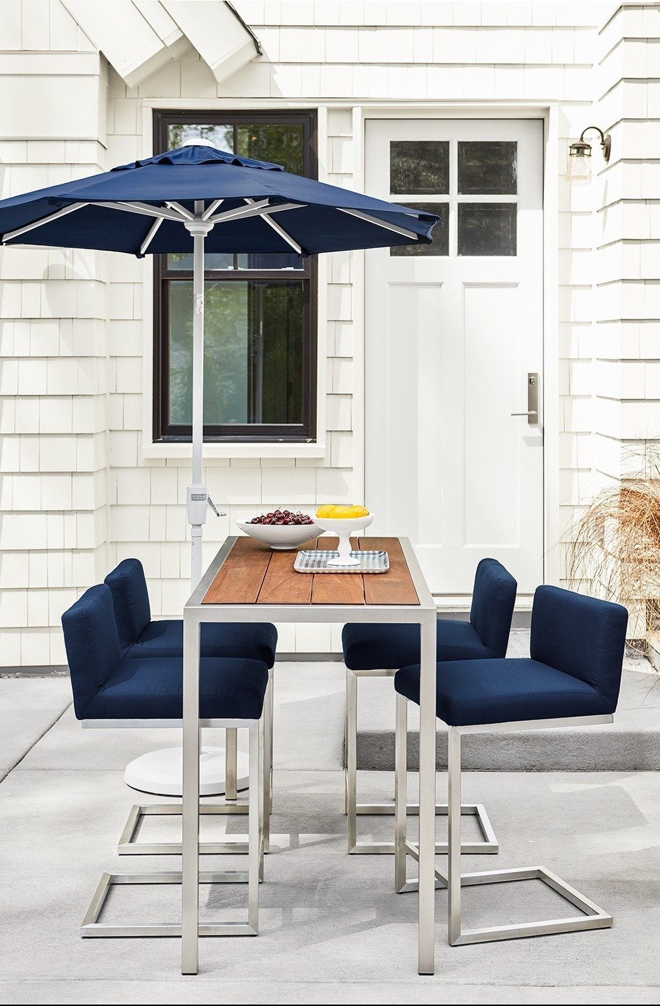 Montego counter table, Finn counter stools, Maui umbrella Tagged: Outdoor, Concrete Patio, Porch, Deck, and Back Yard. Expert Design Advice: Outdoor Dining Spaces - Photo 6 of 8