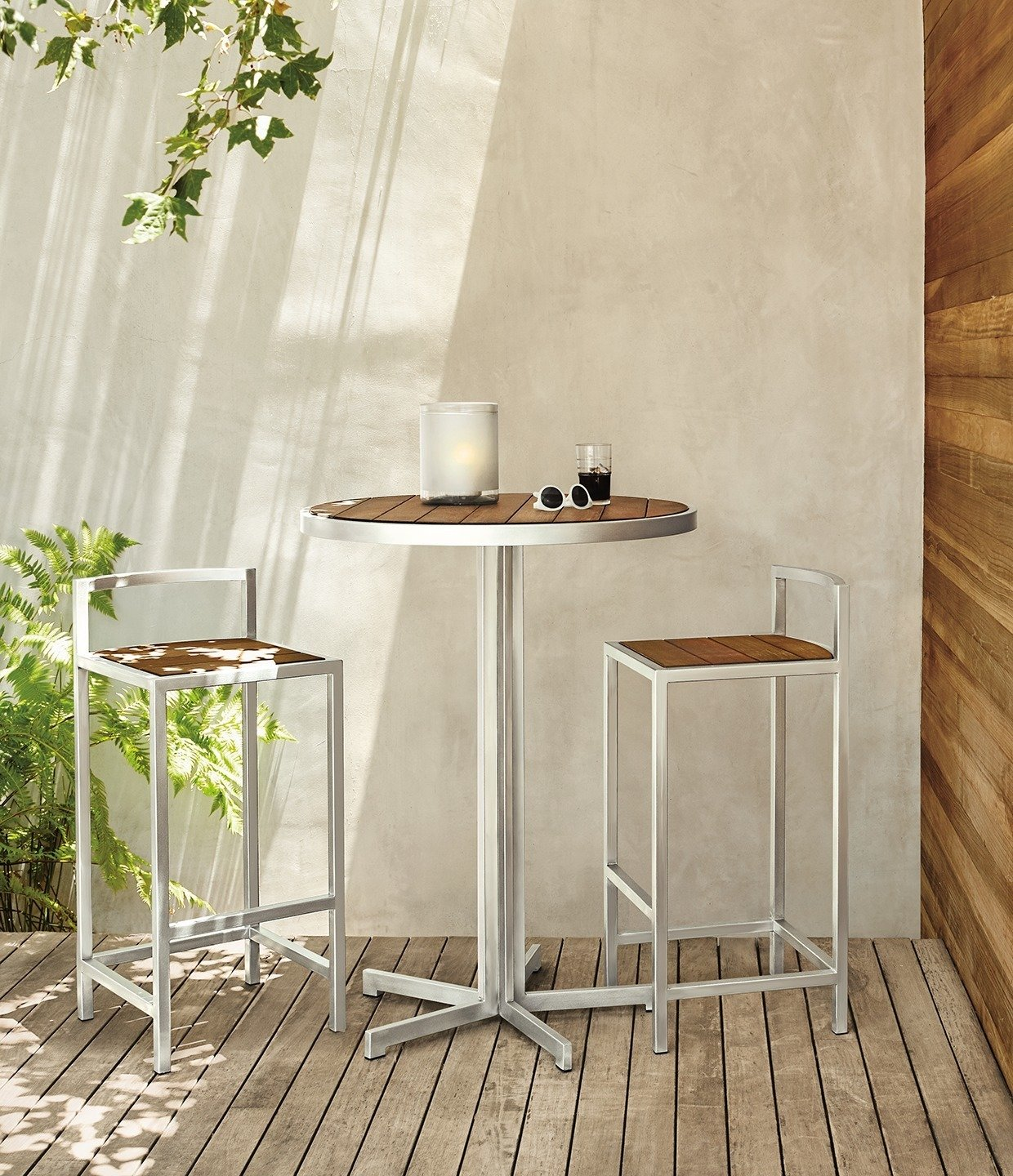 Montego round bar table, Montego bar stools Tagged: Outdoor, Back Yard, Small Patio, Porch, Deck, Side Yard, and Wood Patio, Porch, Deck.  Photo 7 of 8 in Expert Design Advice: Outdoor Dining Spaces