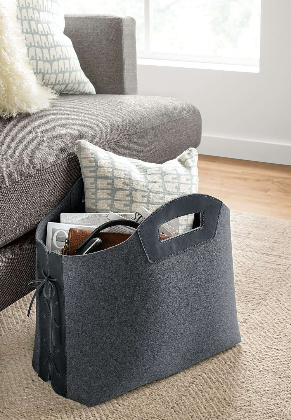 How to Use Modern Home Decor in Unexpected Ways - Photo 2 of 9 - Use an unusual basket or tote as both an organizational tool and statement piece. The tote stands upright so you can easily place it next to your sofa or under your desk.