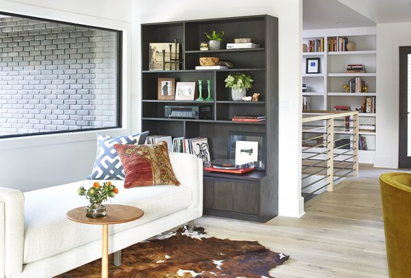 Cade studio sofa, Madison end table, Keaton bookcase, Cowhide rug, Maze pillow