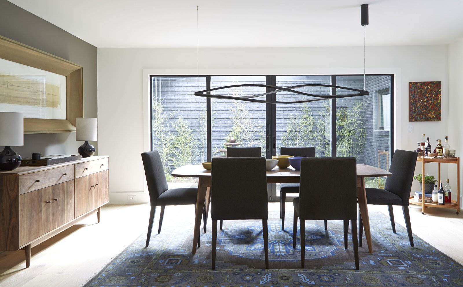 Ventura dining table, Ava chairs, Grove cabinet, Simone lamp, Heriz rug Tagged: Dining Room, Light Hardwood Floor, Table, and Chair.  Photo 4 of 16 in Home Tour: Atlanta Chef Kevin Gillespie