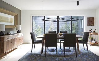 Home Tour: Atlanta Chef Kevin Gillespie - Photo 3 of 15 - Ventura dining table, Ava chairs, Grove cabinet, Simone lamp, Heriz rug