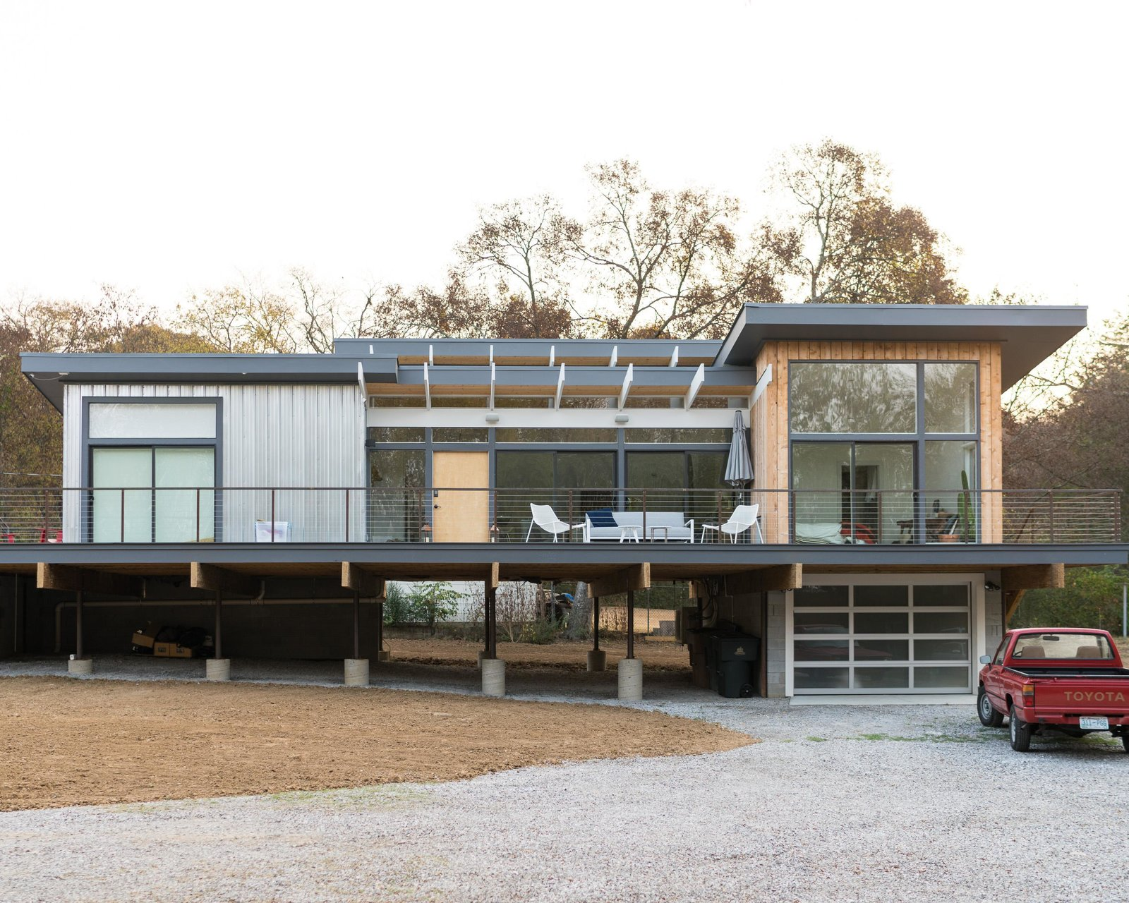Theron Humphrey's new home in Nashville, Tenn. Tagged: Exterior, Flat RoofLine, House, Wood Siding Material, and Metal Siding Material.  Photo 1 of 11 in Home Tour: Theron Humphrey of This Wild Idea