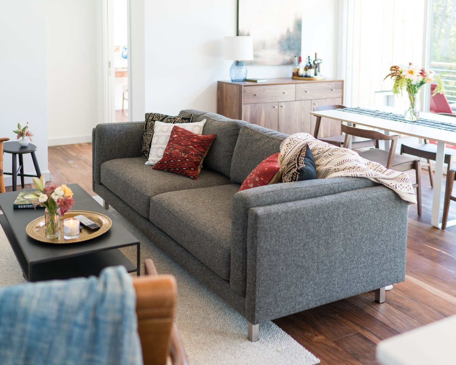 Cade sofa and Slim cocktail table Tagged: Living Room, Sofa, Medium Hardwood Floor, and Coffee Tables.  Photo 4 of 11 in Home Tour: Theron Humphrey of This Wild Idea