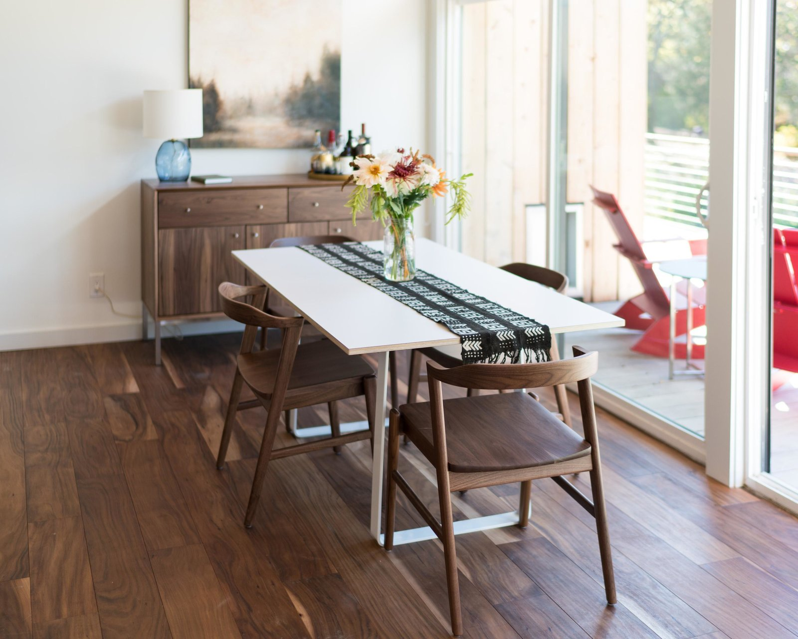 Micah table and Jansen chairs Tagged: Dining Room, Chair, Table, and Medium Hardwood Floor.   from Home Tour: Theron Humphrey of This Wild Idea