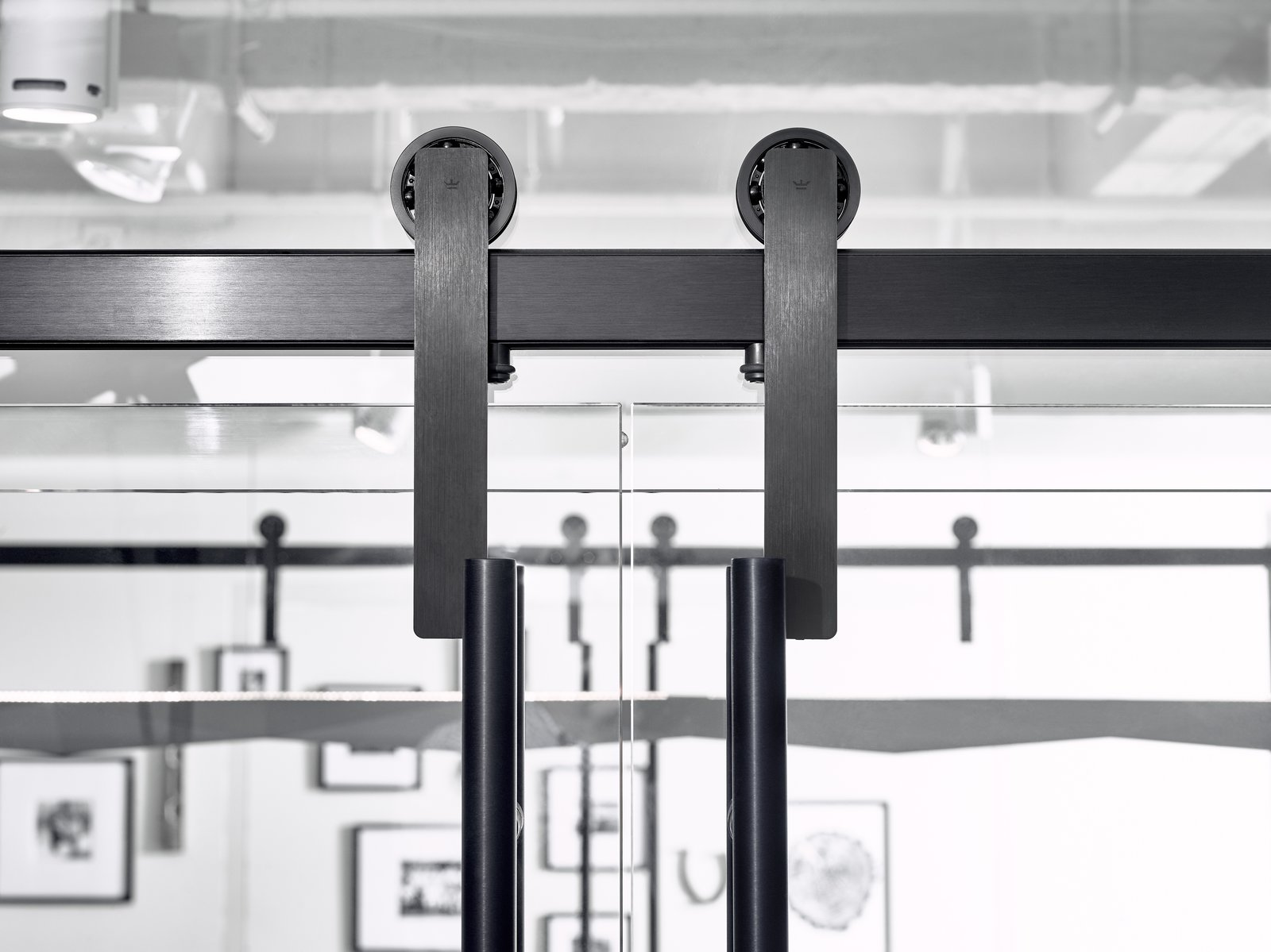 When OFS designed their downtown LA showroom, they used Ragnar sliding door hardware for their glass curtain-walled conference room.  Ragnar Sliding Door Hardware by Krownlab