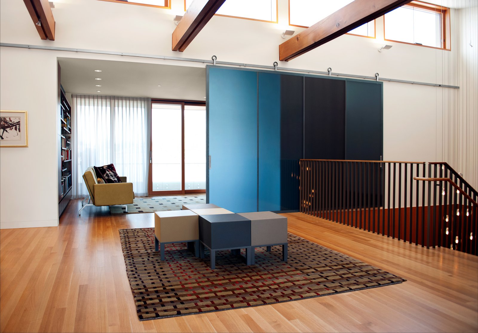 The DECA Architecture team designed a central gallery that connects the main stairwell entry to the dining room and living room.