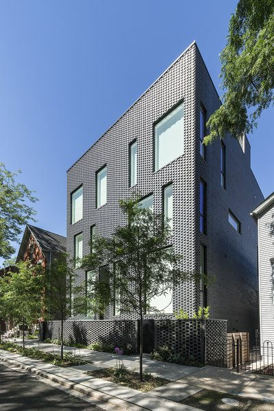 "Modern home with outdoor, front yard, side yard, and trees. Entry facade and brick pattern ""fade"" Photo 2 of Mohawk House"