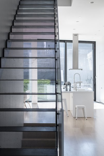 Modern home with staircase, metal tread, and metal railing. Main interior stair made of perforated, powder-coated steel.  Photo 6 of Mohawk House