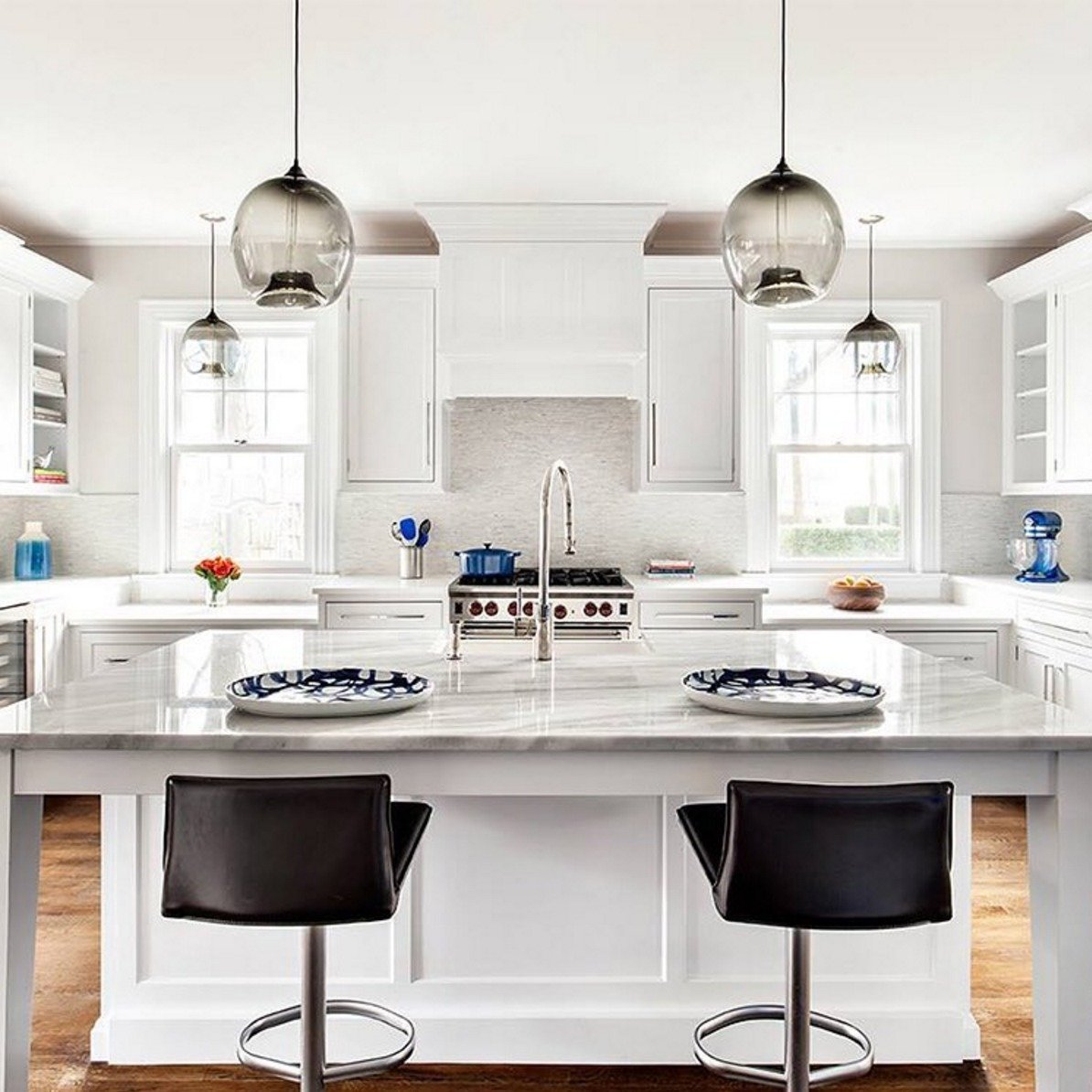 #Kitchen island and kitchen #counter #pendant #lighting come together in this #modern #interior by Clean Design Partners.