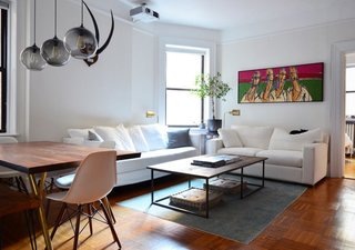Table Pendant Lighting Adds to New York City Home's Unique Minimalism - Photo 1 of 3 -