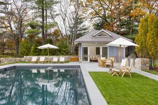 Historic Massachusetts Home Uses Modern Pendant Lights in Pool House - Photo 3 of 3 -