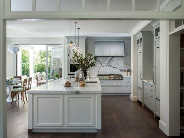 Colored Glass Pendant Lights Over Kitchen Island