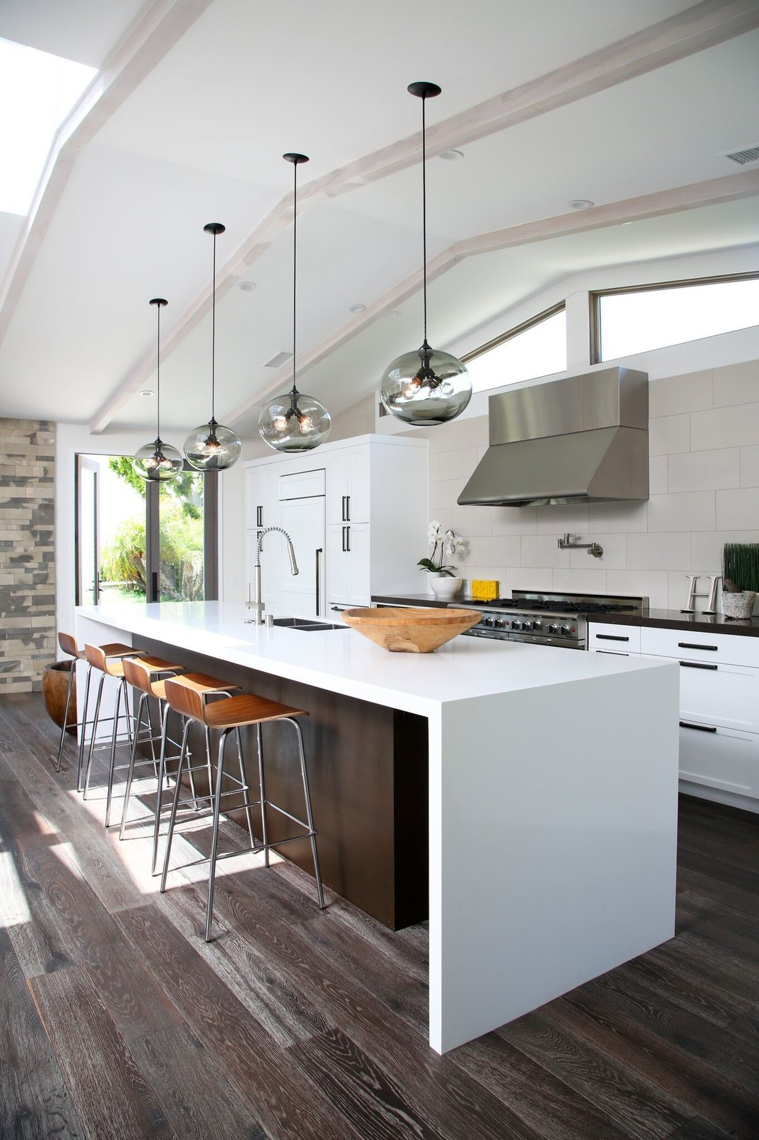 Photo 5 of 10 in 10 Open Kitchen Solutions That Will Get Things Cooking from Kitchen Island Modern Lighting Adds Minimalist Feel to California Home