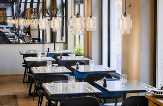 Guests Enjoy Meal Under Modern Restaurant Pendant Lighting in Sweden - Photo 1 of 3 -