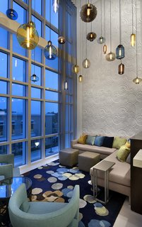 Modern Hotel Lighting Adorns Lobby of Hilton Resort in Myrtle Beach - Photo 2 of 4 -