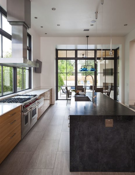 Modern home with kitchen, wood cabinet, and pendant lighting. Photo 2 of Strait Lane