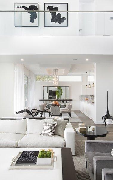 Modern home with kitchen, marble counter, wood cabinet, dark hardwood floor, and pendant lighting. Photo 3 of Santa Barbara Estate