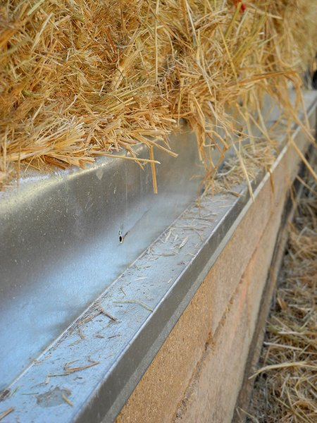 Rice straw bale, sourced from a local farmer, were placed on top of the Watershed Block walls, sequestering carbon while insulating the home. Photo 20 of Healdsburg Family House modern home
