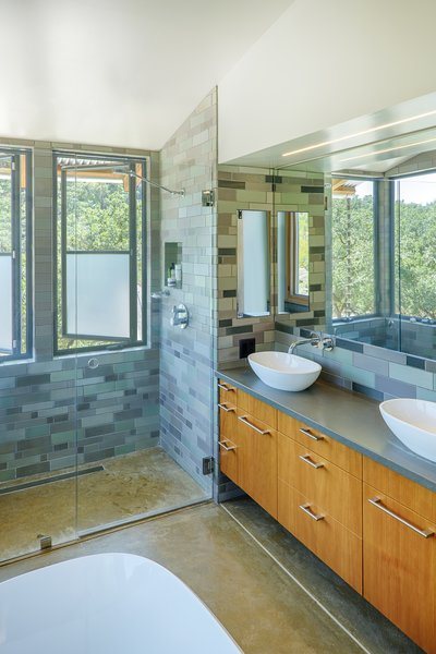The master shower features views across the creek to the ridge beyond. Photo 12 of Healdsburg Family House modern home