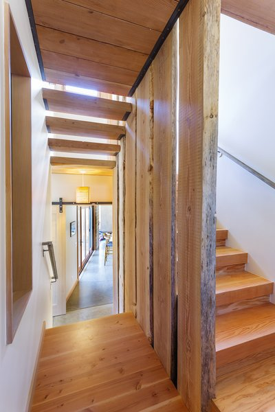 Douglas Fir planks and flooring were harvesting on-site and used throughout the stairwell and upper levels. Photo 10 of Healdsburg Family House modern home