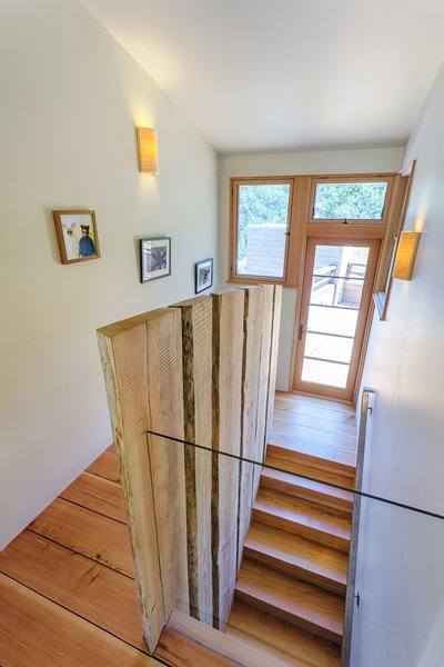 Live-edge oak harvested on site was used as both structure and guardrail at the central stair to the bedroom wing.  Photo 7 of Healdsburg Family House modern home