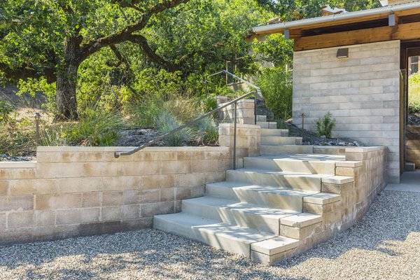 Watershed Block earth masonry retaining walls limited the number of concrete deliveries at the remote location, and provided a warm, variegated texture. Photo 6 of Healdsburg Family House modern home