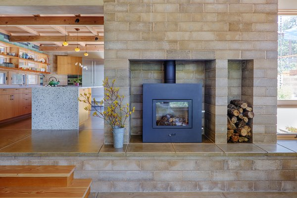 Radiant-heat in the concrete floors, along with the Watershed Block hearth and wood stove provide a boost of heat on cool, cloudy days. Photo 4 of Healdsburg Family House modern home