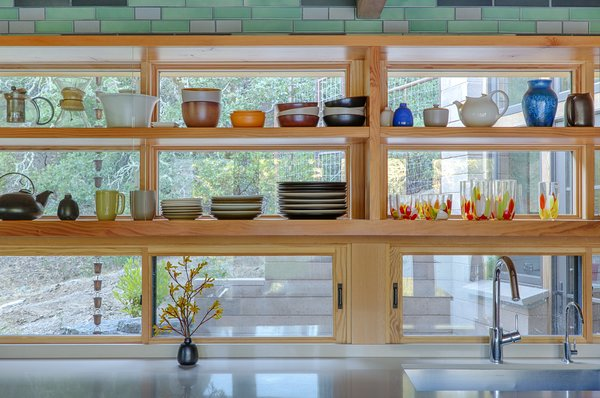 The kitchen transparently links the bars of living space and bedrooms - glass-backed open shelving keeps the space bright. Photo 3 of Healdsburg Family House modern home