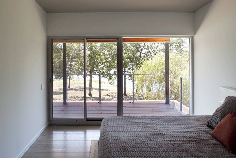 The entire house utilizes natural daylight and natural ventilation.  #daylight #interior #bedroom #windows #postcardhouse #kimberlingcity #hufft  Photo credit by Andrew Fabin, Matthew Hufft  Postcard House by Hufft