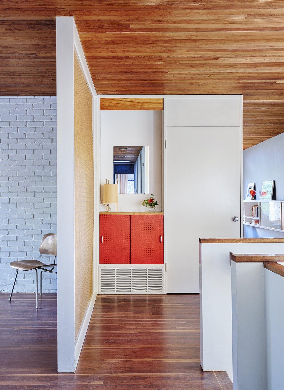 Snower Restoration in Kansas City, Missouri Tagged: Hallway and Dark Hardwood Floor.  Photo 3 of 11 in Dwell's Top 10 Design Pros of 2017 from Snower Restoration